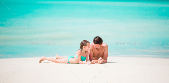 Panorama of father and his adorable little daughter at tropical beach - Stock Photo - Images