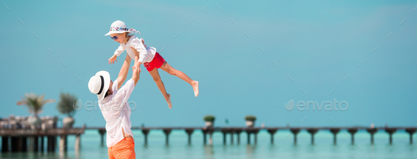 Little girl and young mother during beach vacation - Stock Photo - Images
