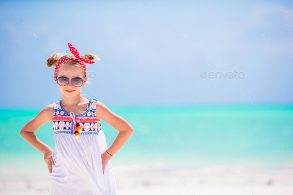 Portrait of little girl on the beach - Stock Photo - Images