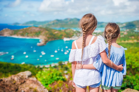 Adorable little kids enjoying the view of picturesque English Harbour at Antigua in caribbean sea - Stock Photo - Images