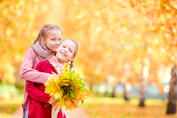 Little happy girl outdoors on a warm autumn day. Kids in fall - Stock Photo - Images