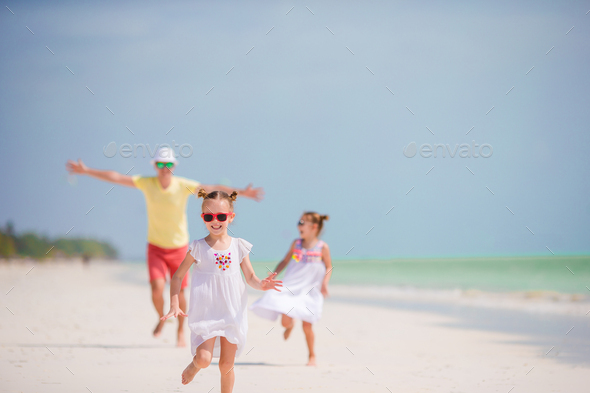 Young family on vacation have a lot of fun - Stock Photo - Images