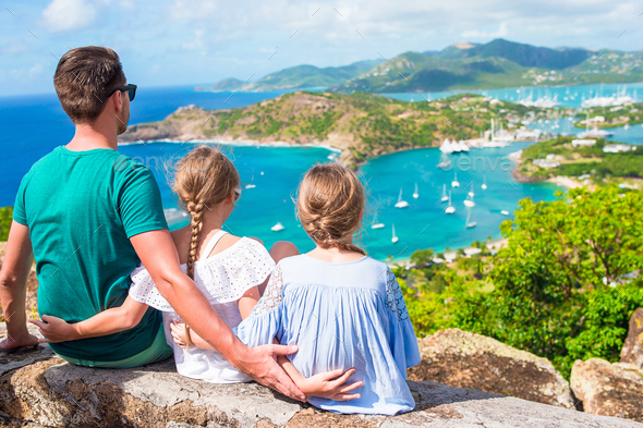 Adorable little kids and young father enjoying the view of picturesque English Harbour at Antigua in - Stock Photo - Images