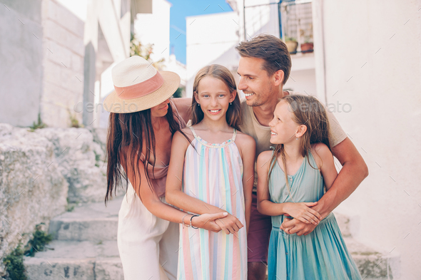 Family of parents and kids vacation in European vacation - Stock Photo - Images