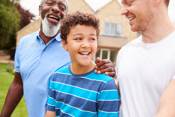 Father With Son And Grandfather From Multi-Generation Mixed Race Family Walking In Garden At Home - Stock Photo - Images