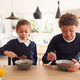Children At Kitchen Counter Eating Sugary Breakfast Before Going To School - PhotoDune Item for Sale