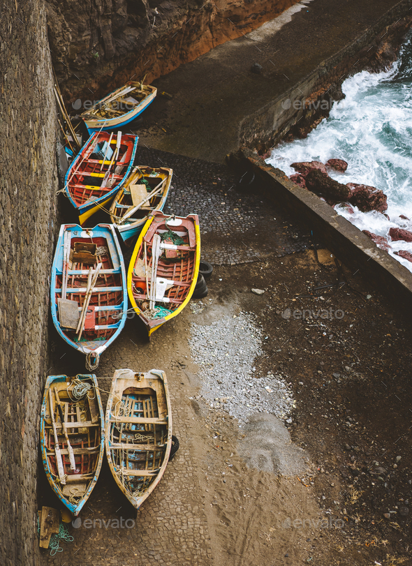 Local traditional fishing boats under shelter during storm in atlantic ocean. View from above, view - Stock Photo - Images