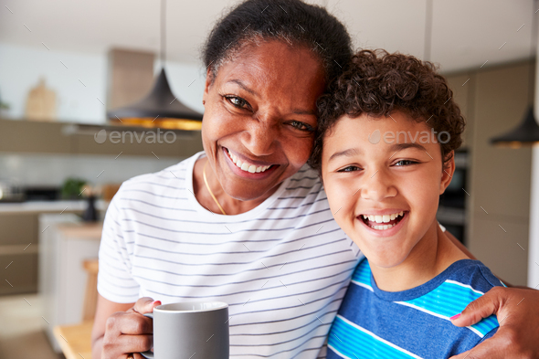 Portrait Of Grandmother Drinking Coffee With Grandson In Kitchen At Home - Stock Photo - Images