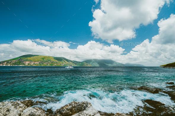 Beautiful cloudscape near Fiskardo, Kefalonia, Ionian islands, Greece. Crystal clear transparent - Stock Photo - Images