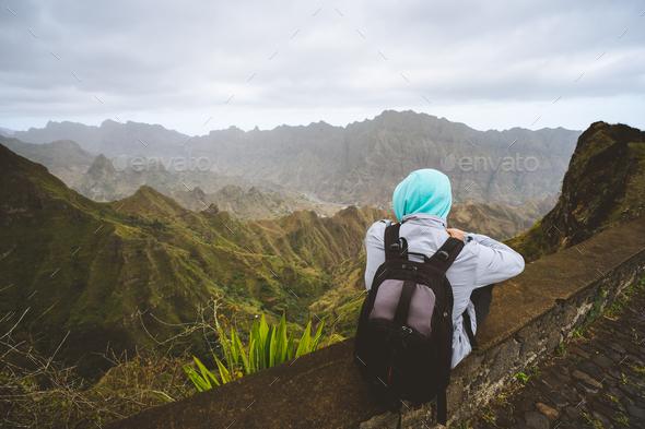 Traveler enjoying magnificent view of huge mountain range on Santo Antao island, Cape Verde - Stock Photo - Images