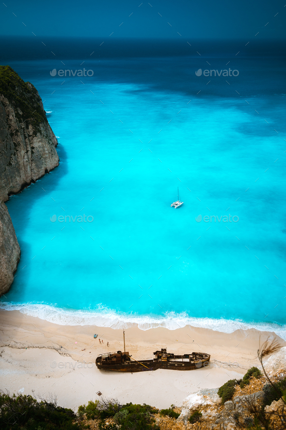 Shipwreck in Famous Navagio beach. Azure turquoise sea water and paradise sandy beach. Tourist - Stock Photo - Images