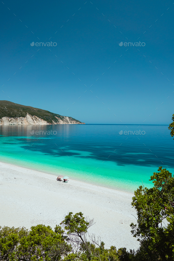 Couple enjoying the summer on one of the most beautiful beaches of Greece on Kefalonia Island Ionian - Stock Photo - Images