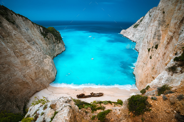 Shipwreck in Navagio beach. Azure turquoise sea water and paradise sandy beach. Famous tourist - Stock Photo - Images