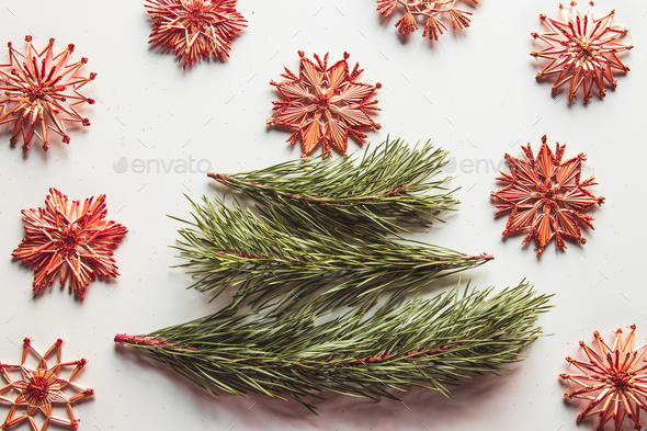 Christmas tree made from pine leaves and straw toys - Stock Photo - Images