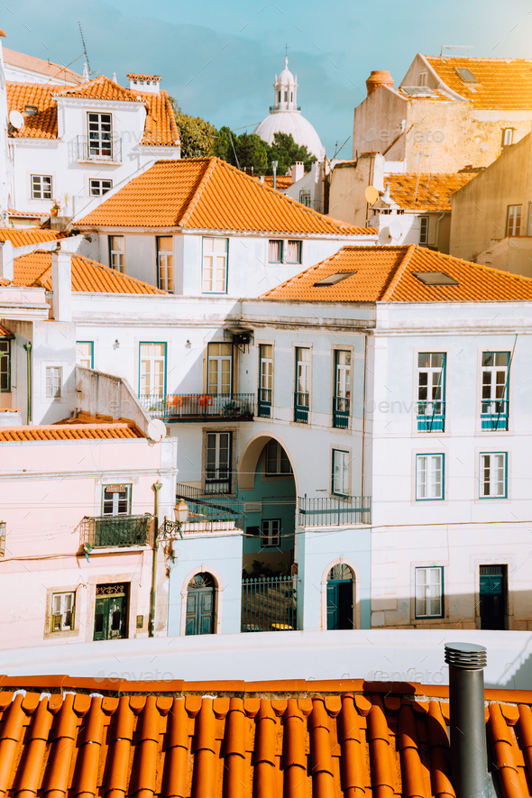 Colorful red and white citycape of Lisbon. Historical downtown built on the side of the hill. Bright - Stock Photo - Images