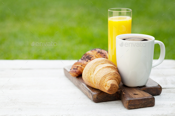 Coffee, orange juice and croissant - Stock Photo - Images