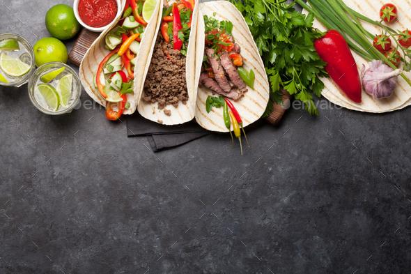 Mexican tacos and caipirinha cocktail - Stock Photo - Images