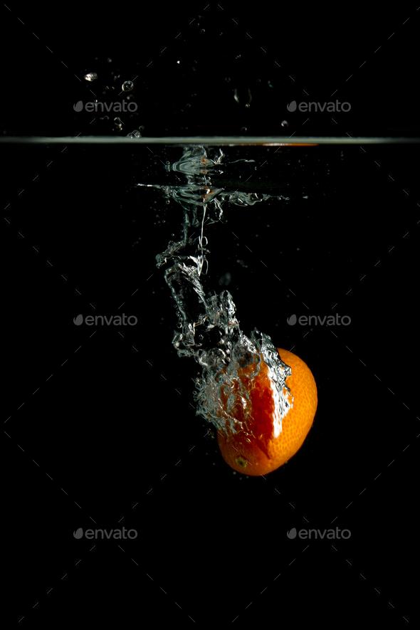 Kumquat falls under water - Stock Photo - Images