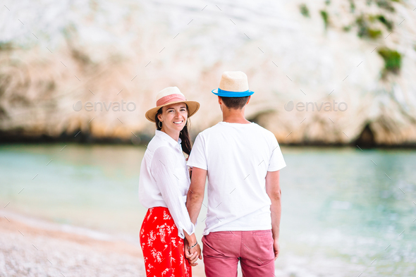 Young couple on white beach during summer vacation - Stock Photo - Images