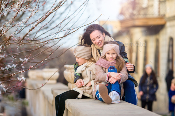 Mother and little daughters outdoor in city - Stock Photo - Images