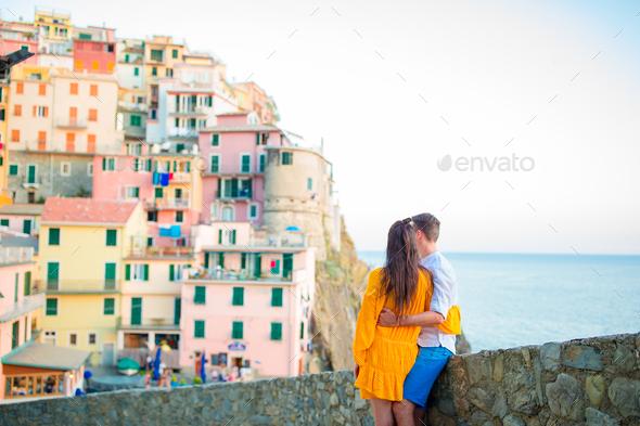 Happy couple background stunning village of Manarola, Cinque Terre, Liguria, Italy - Stock Photo - Images