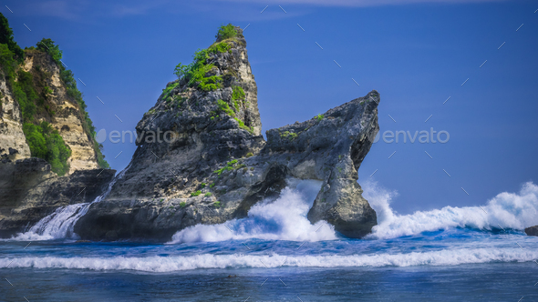 Huge Wave hitting the Rock in the ocean at Atuh beach on Nusa Penida island, Indonesia - Stock Photo - Images