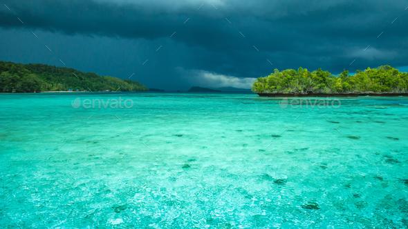 Beautiful Blue Lagoone shortly before Thunderstorm, Gam Island, West Papuan, Raja Ampat, Indonesia - Stock Photo - Images