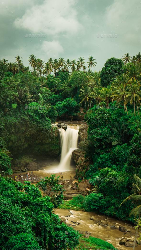 Tegenungan Waterfall. Ubud in Bali, Indonesia. Vertical orientation - Stock Photo - Images