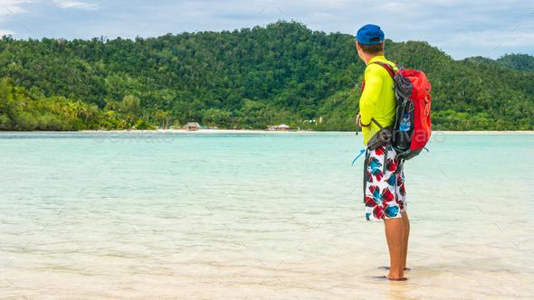 Happy Traveler on White Sand Bank during Low Tide, Kri Island. Raja Ampat, Indonesia, West Papua - Stock Photo - Images