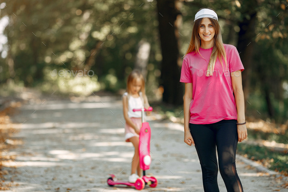 Mother with daughter playing in a summer park - Stock Photo - Images