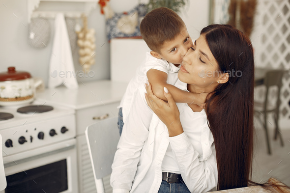 Mother with little son having fun at home - Stock Photo - Images