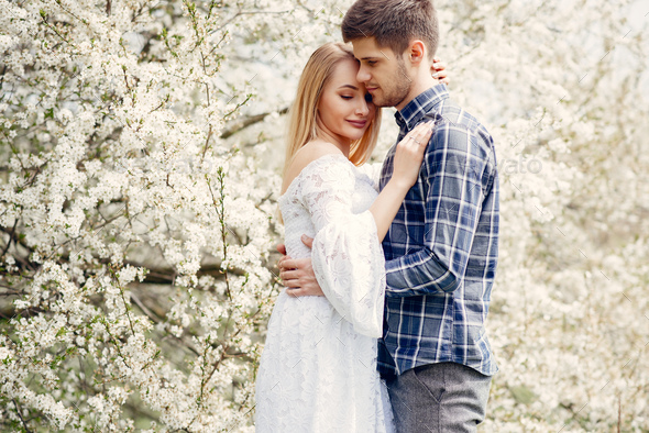 Beautiful couple spend time in a summer park - Stock Photo - Images