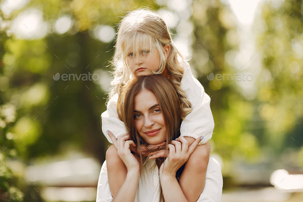 Mother with little daughter playing in a summer park - Stock Photo - Images