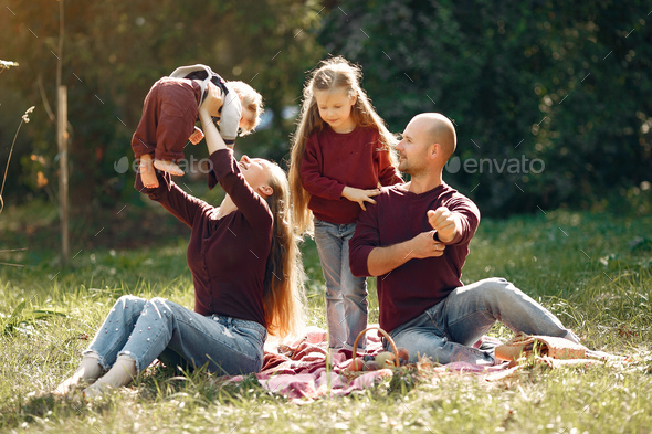 Family with cute kids in a autumn park - Stock Photo - Images