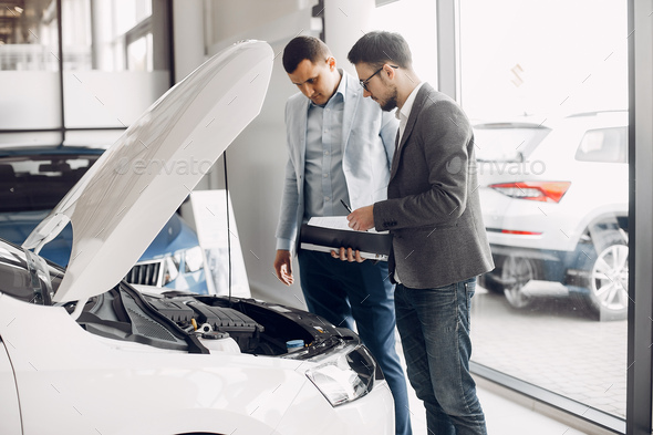 Handsome and elegant man in a car salon - Stock Photo - Images