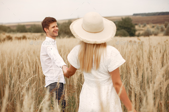 Beautiful couple spend time in a autumn field - Stock Photo - Images