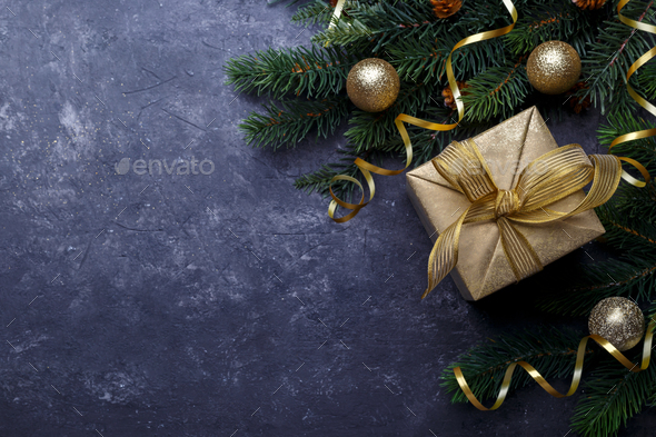 Golden gift box on black background - Stock Photo - Images
