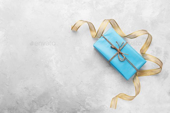 Blue gift box on grey stone background - Stock Photo - Images