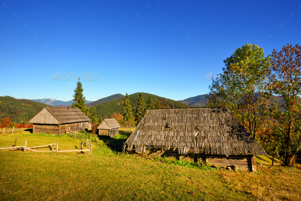 Beautiful landscape with old wooden huts in the Carpathians moun - Stock Photo - Images