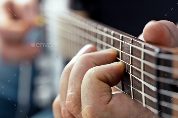 playing on electric guitar - Stock Photo - Images