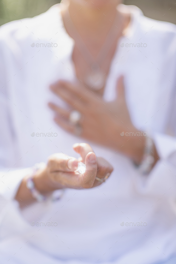 Increasing Positive Energy with Crystal, Practicing Mindfulness - Stock Photo - Images