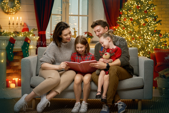 family near Christmas tree - Stock Photo - Images