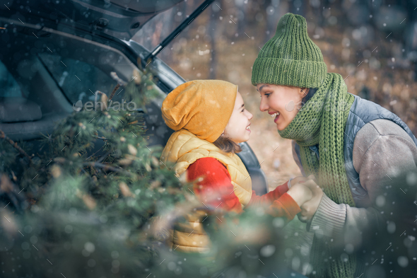 Mother, child and car on snowy winter nature - Stock Photo - Images