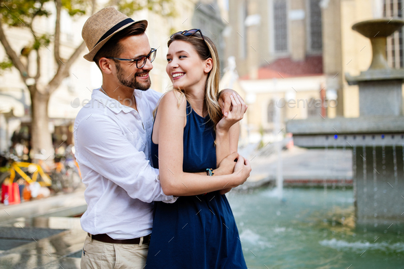 Beautiful couple in love travel, smiling, dating outdoors - Stock Photo - Images