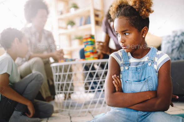 Little rebelious girl has conflict with family. Family problems. Social misbehaviour - Stock Photo - Images