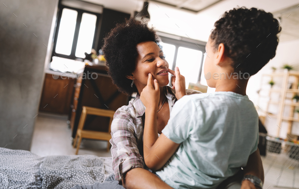 Happy young african american mother having fun with her child - Stock Photo - Images