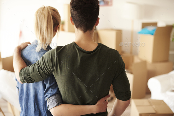 Rear view of embraced loving couple - Stock Photo - Images