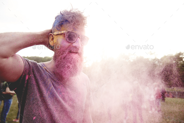 Pink powder on the man at the festival - Stock Photo - Images