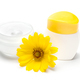 Jars of natural skin care cream with yellow flower - PhotoDune Item for Sale