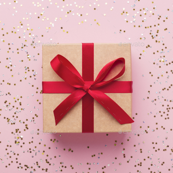 Top view of creative gift on glowing pink - Stock Photo - Images